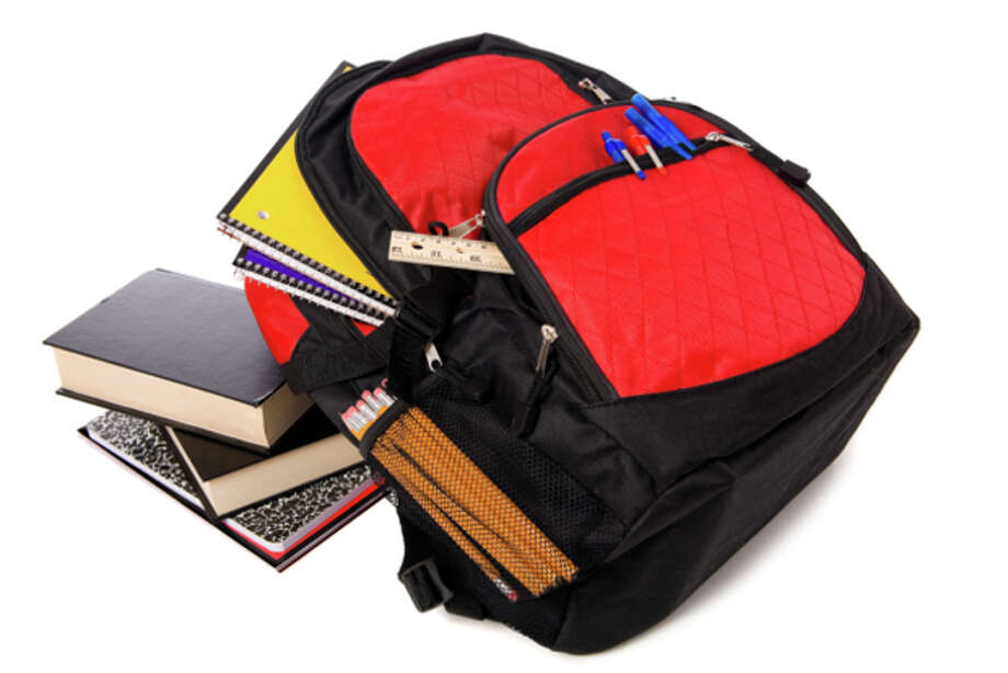 School Backpack Overflowing with supplies / Hemera