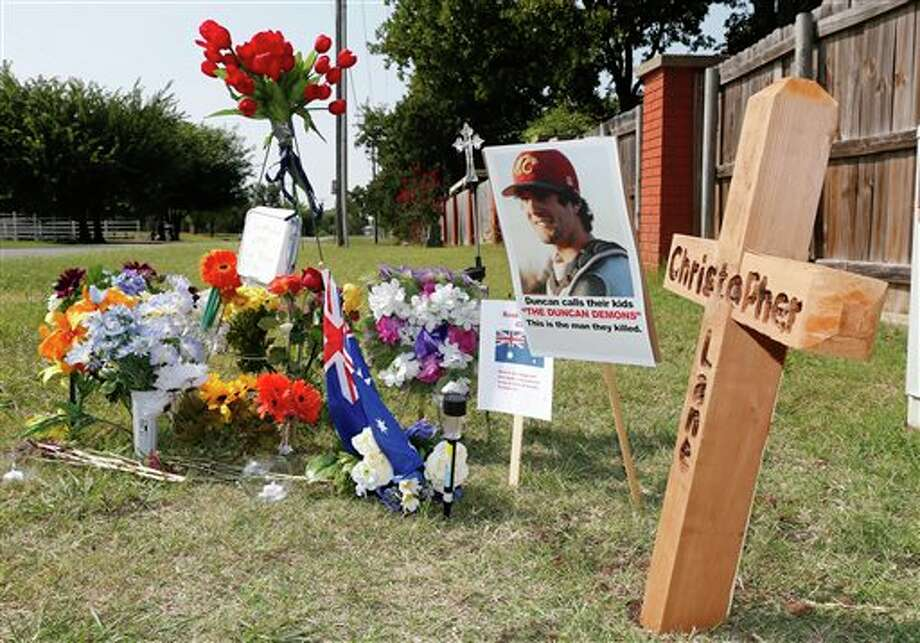 A memorial to Christopher Lane is shown Tuesday, Aug. 20, 2013, along the road where he was shot and killed, in Duncan, Okla. Lane, an Australian who was on a baseball scholarship at East Central University in Ada, Okla., was in Duncan visiting his girlfriend, when he was shot and killed Friday, Aug. 16, 2013. (AP Photo/Sue Ogrocki) Photo: Sue Ogrocki / AP