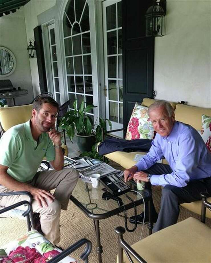 In this Aug. 18, 2013 image released by Beau Biden's Twitter account, @BeauBiden, Vice President Joe Biden sits with his son Beau Biden, in Delaware. A spokesman for the Department of Justice says Monday, Aug. 19, 2013, Delaware Attorney General Beau Biden has been hospitalized after becoming weak and disoriented after a drive for a family vacation. Spokesman Jason Miller said late Monday that Biden, the vice president's son, is currently undergoing testing in Houston to investigate the cause of his symptoms. (AP Photo/@BeauBiden) Photo: HOPD / @BeauBiden