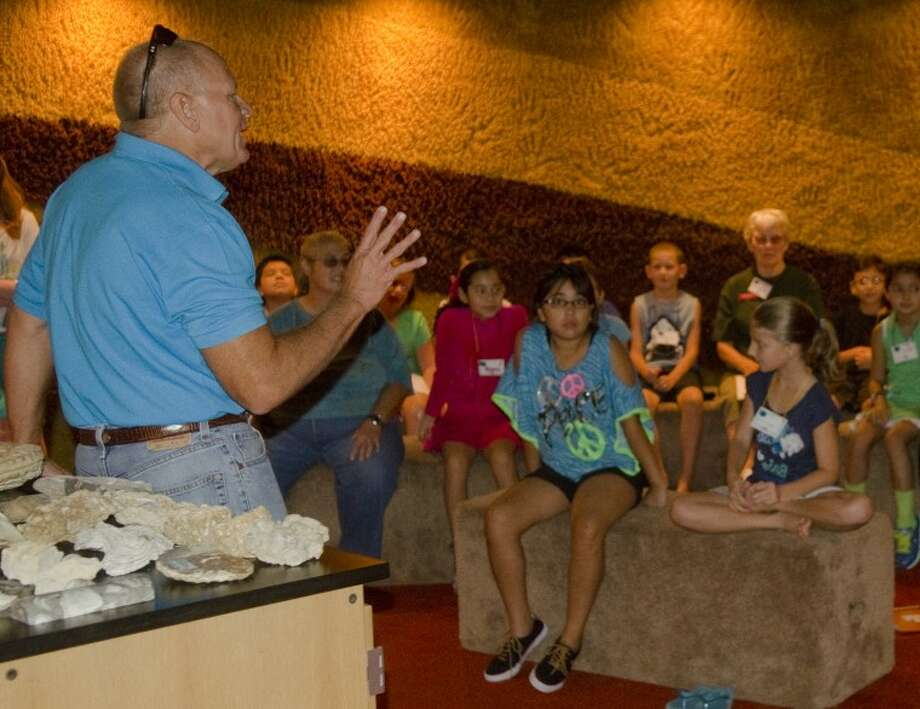David Osterlund, geologist with Great Western, speaks Friday to children about fossils found in the Permian Basin during a summer class On the Ocean Floor at the Petroleum Museum. Photo by Tim Fischer\ Reporter-Telegram Photo: Tim Fischer