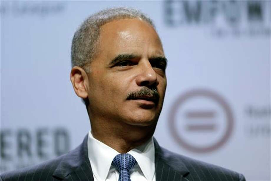 Attorney General Eric Holder speaks at the National Urban League annual conference, Thursday, July 25, 2013, in Philadelphia. Holder announced Thursday the Justice Department is opening a new front in the battle for voting rights in response to a Supreme Court ruling that dealt a major setback to voter protections. Holder said the Justice Department is asking a federal court in San Antonio to require the state of Texas to obtain approval in advance before putting future voting changes in place. (AP Photo/Matt Rourke) Photo: Matt Rourke / AP
