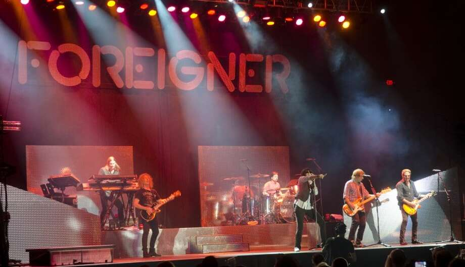 Members of Foreigner perform Thursday night at the Chap Center as a fundraiser for the MISD Education Foundation. Tim Fischer/Reporter-Telegram Photo: Tim Fischer
