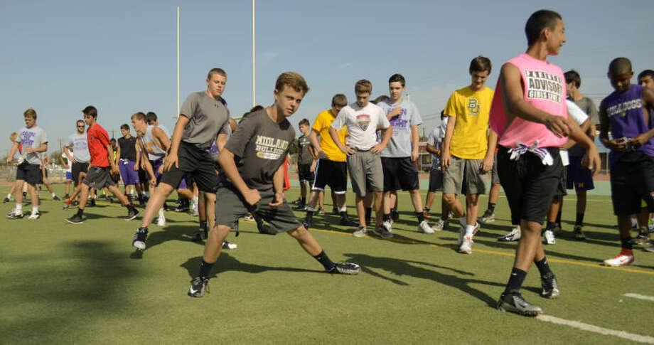 Area football players run drills during Bulldog Football Camp at Memorial Stadium. Tim Fischer\Reporter-Telegram Photo: Tim Fischer