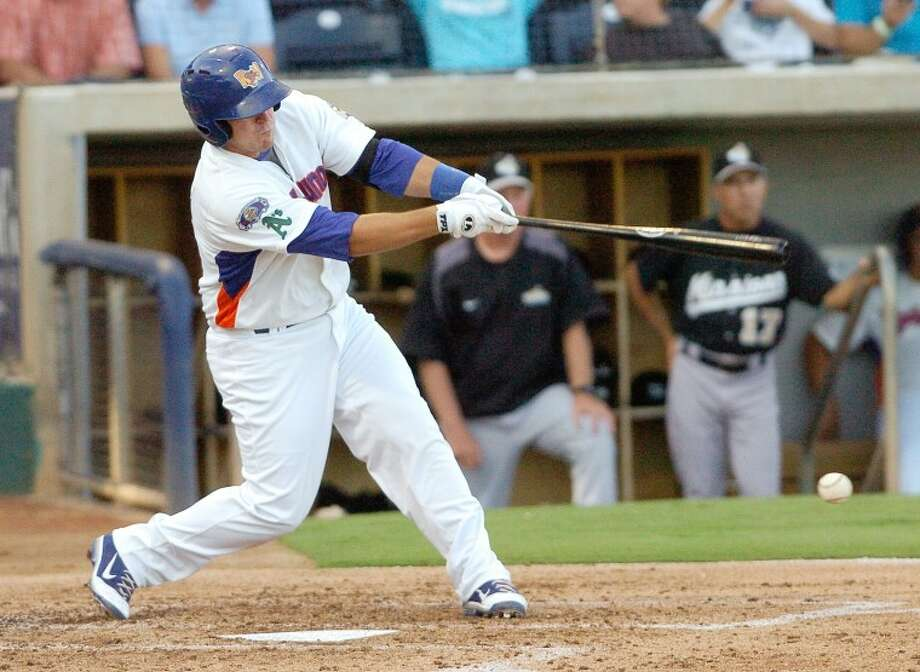 RockHounds Michel Spina (18) hits a RBI single during the second inning of the Hounds game against the San Antonio Missions at Citibank Ballpark. Cindeka Nealy/Reporter-Telegram Photo: Cindeka Nealy
