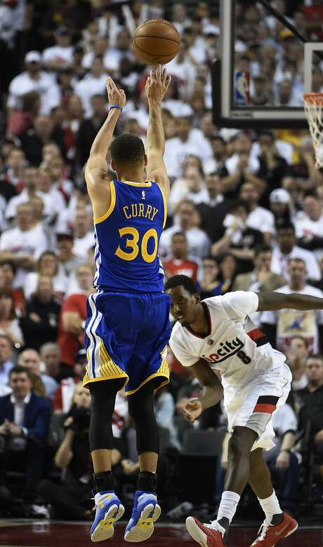 Stephen Curry hits an overtime shot over Portland's Al-Farouq Aminu on Monday night during a scintillating playoff performance that will be long remembered. Photo: Steve Dykes, Getty Images