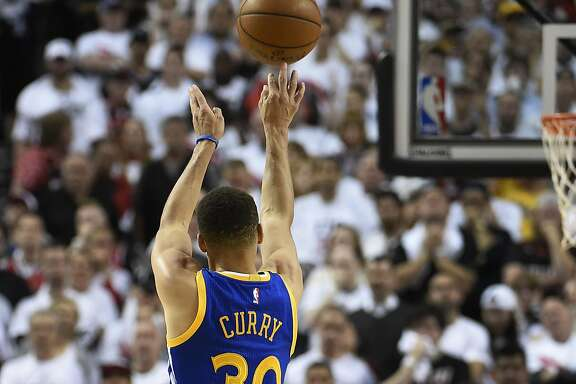 PORTLAND, OR - MAY 9: Stephen Curry #30 of the Golden State Warriors hits a shot over Al-Farouq Aminu #8 of the Portland Trail Blazers during overtime  of Game Four of the Western Conference Semifinals during the 2016 NBA Playoffs at the Moda Center on May 9, 2016 in Portland, Oregon. The Warriors won 132-125. NOTE TO USER: User expressly acknowledges and agrees that by downloading and/or using this photograph, user is consenting to the terms and conditions of the Getty Images License Agreement.  (Photo by Steve Dykes/Getty Images)
