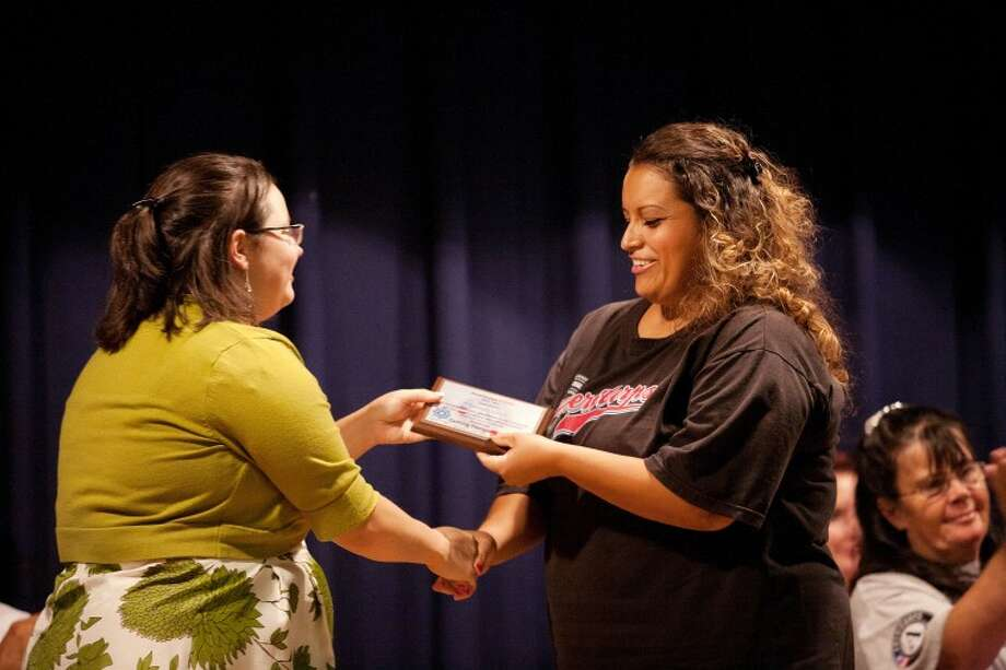 Monique Waggoner presents Claudia Chavez with a certificate for completing her term of service with AmeriCorps Thursday during the AmeriCorps STARS Commencement Ceremony 2011 at the Hispanic Cultural Center. Photo: Cindeka Nealy/Reporter-Telegram