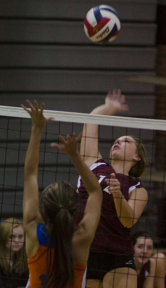 Lee High's Jenn Jeter goes up to put a kill down as Central's Sophia Flores tries to block Friday evening at LHS. Tim Fischer/Reporter-Telegram Photo: Tim Fischer