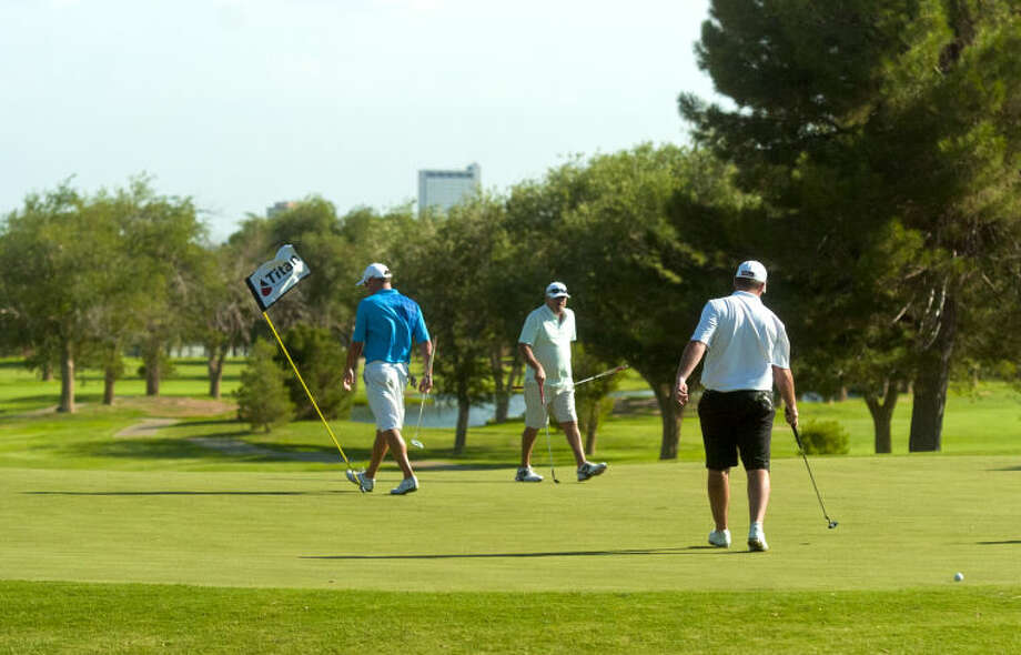 Golfers walk across the green during the first day of the Blowout Tournament at Ranchland Hills Golf Club. James Durbin/Reporter-Telegram Photo: JAMES DURBIN