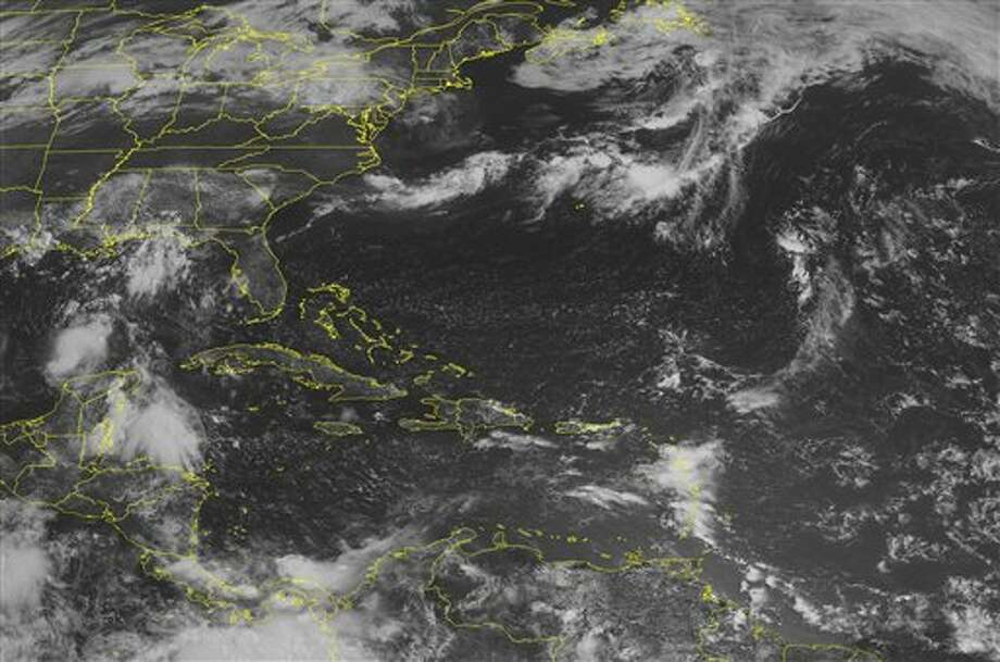 This NOAA satellite image taken Thursday, July 28, 2011 at 10:45 AM EDT shows Tropical Storm Don is spinning just to the north of the Yucatan Peninsula. (AP Photo/Weather Underground) Photo: AP / WEATHER UNDERGROUND