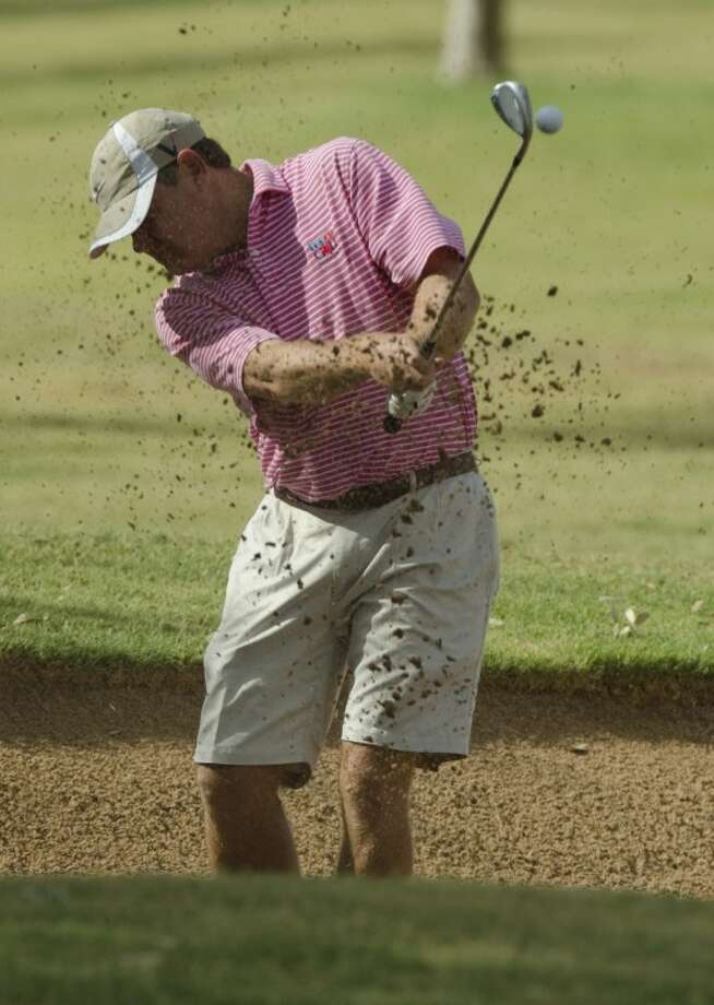 Sam Hansard hits out of a bunker Saturday at the Midland Invitational Tournament at Midland Country Club. Tim Fischer/Reporter-Telegram Photo: Tim Fischer