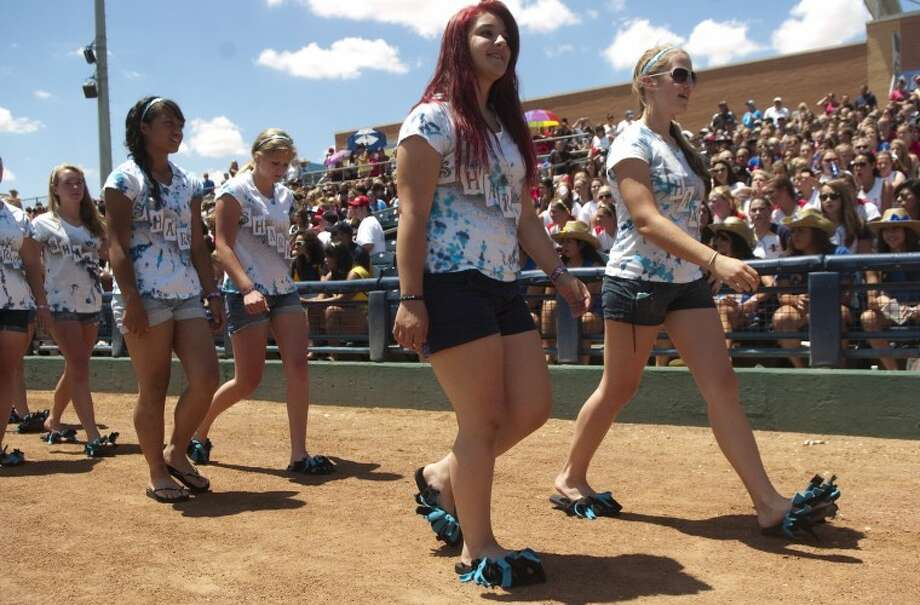 Members of the Lady Sharks from Redmond Washington make their way onto the field Sunday as they and other teams are announced at the opening ceremonies of the ASA 14 and under National Softball Tournament. Photo by Tim Fischer/Midland Reporter-Telegram Photo: Tim Fischer