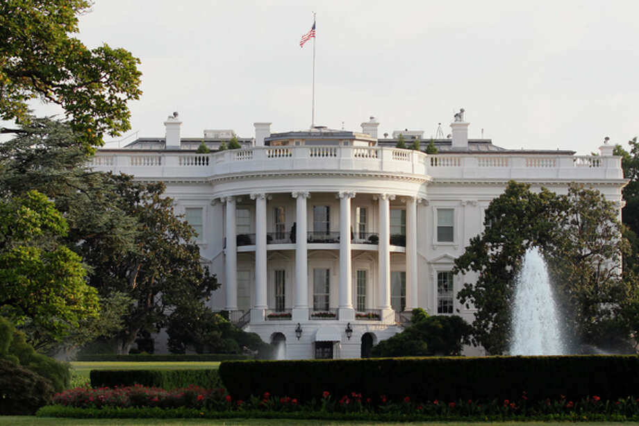 The White House is seen early Sunday, July 31, 2011. (AP Photo/Carolyn Kaster) Photo: Carolyn Kaster / AP