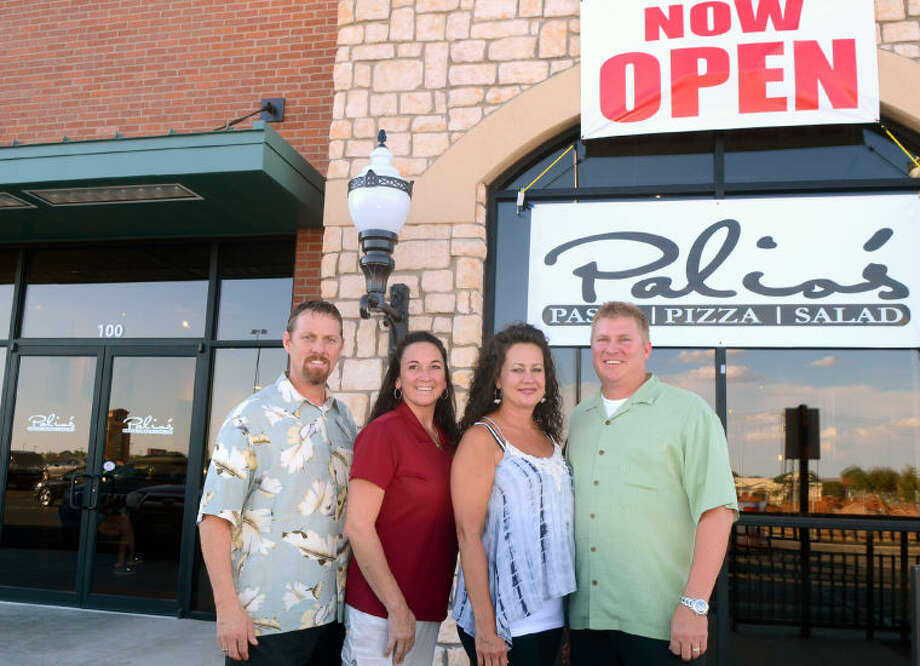 Palio's Pizza owners Matt Turner, Michelle Turner, Shanda Turner and Paul Turner stand outside the newly opened restaurant located on the north Loop 250 outer road between Garfield and Midkiff. James Durbin/Reporter-Telegram Photo: JAMES DURBIN