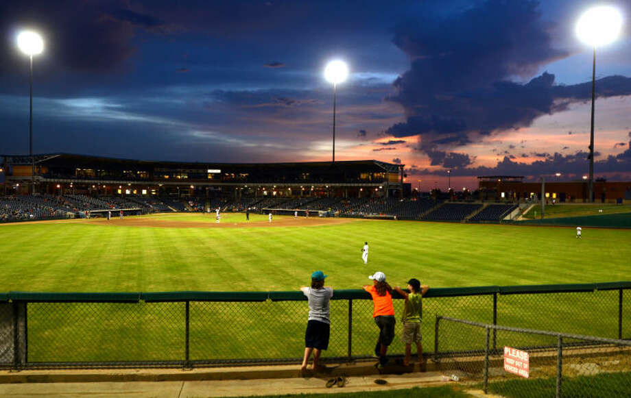 Young Rockhounds fans watch the hill overlooking center field during the game against Frisco Tuesday at Citibank Ballpark. James Durbin/Reporter-Telegram Photo: JAMES DURBIN
