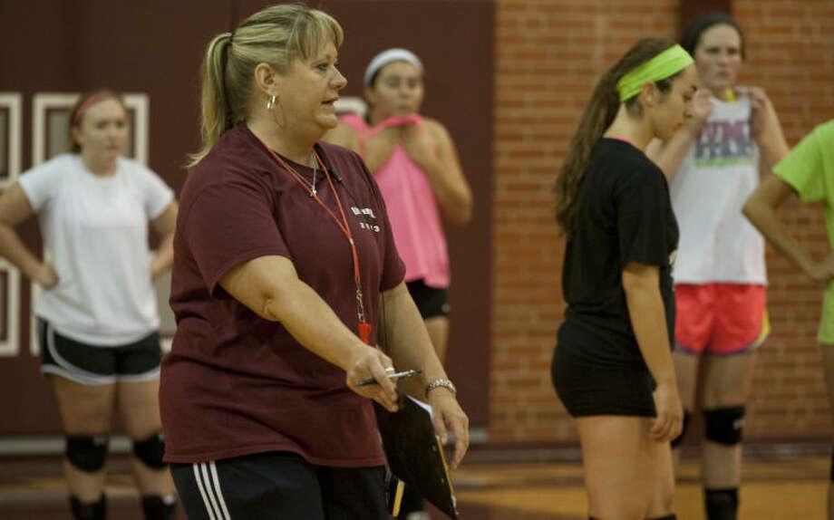Lee volleyball coach Daphne Rhoads talks with her players Monday during practice. Tim Fischer\Reporter-Telegram Photo: Tim Fischer