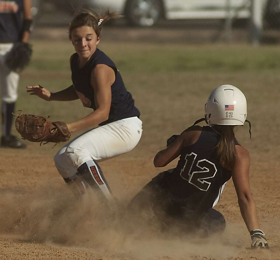 St. Louis Angels' Talisa Morton safely slides into second for a double as West Texas Chaos' Ally Leal tries to make the tag Tuesday in the ASA National Tournament at Freddie Ezell Softball Complex. Photo: Tim Fischer/Reporter-Telegram