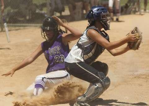 Sacrificing for softball is worthwhile, families say