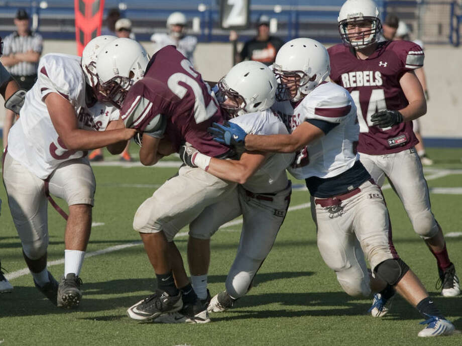 Lee football players compete Friday in the annual Maroon and White Spring football scrimmage at Grande Communication Stadium. Tim Fischer\Reporter-Telegram Photo: Tim Fischer