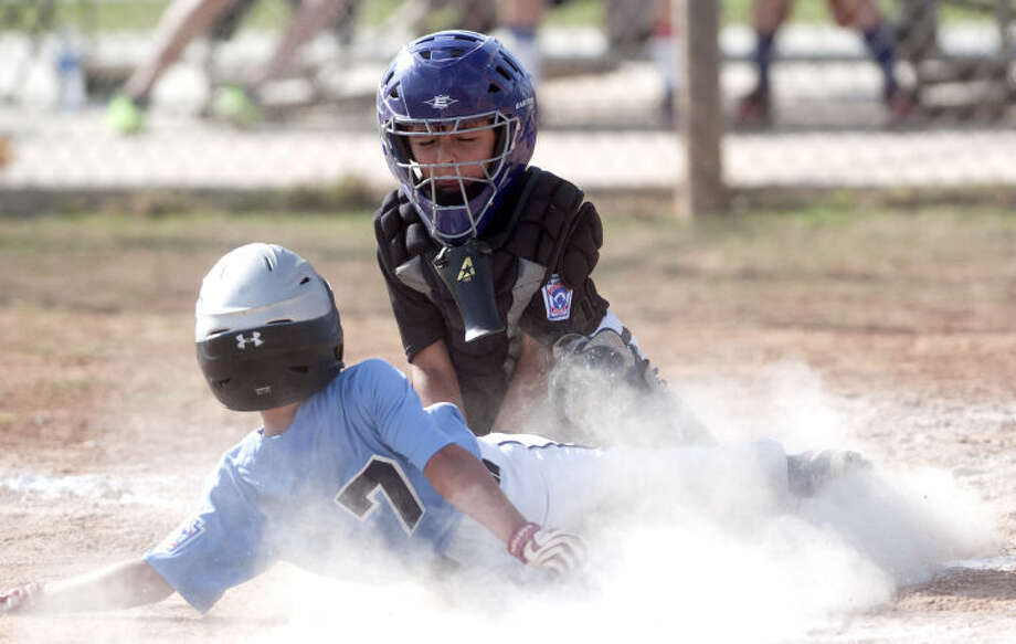 Mid-City catcher Nautas Weirhausen tags out Lubbock Southwest's Brady Alexander during the Little League sectional tournament Monday at Butler Park. James Durbin/Reporter-Telegram Photo: JAMES DURBIN