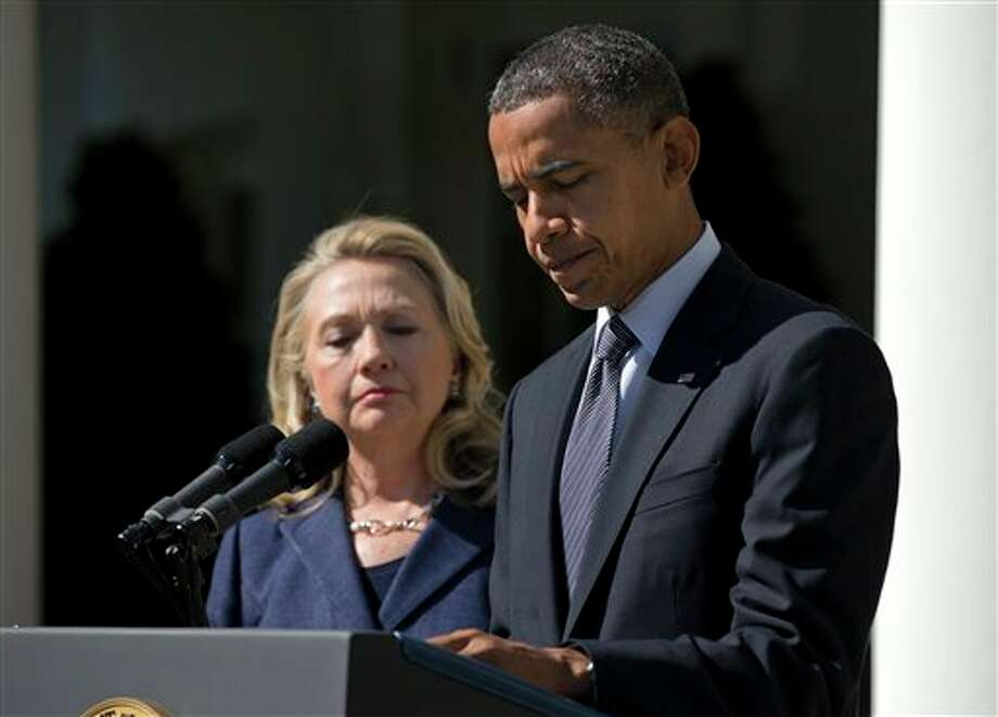 President Barack Obama, accompanied by Secretary of State Hillary Rodham Clinton, speaks about the death of U.S. ambassador to Libya Christopher Stevens, Wednesday, Sept. 12, 2012, in the Rose Garden of the White House in Washington. (AP Photo/Evan Vucci) Photo: Evan Vucci / AP