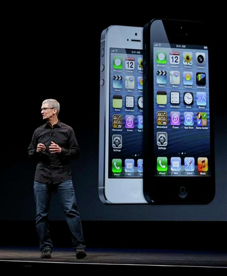 Apple CEO Tim Cook talks on stage during the introduction of the new iPhone 5 in San Francisco, Wednesday, Sept. 12, 2012. (AP Photo/Eric Risberg) Photo: Eric Risberg / AP