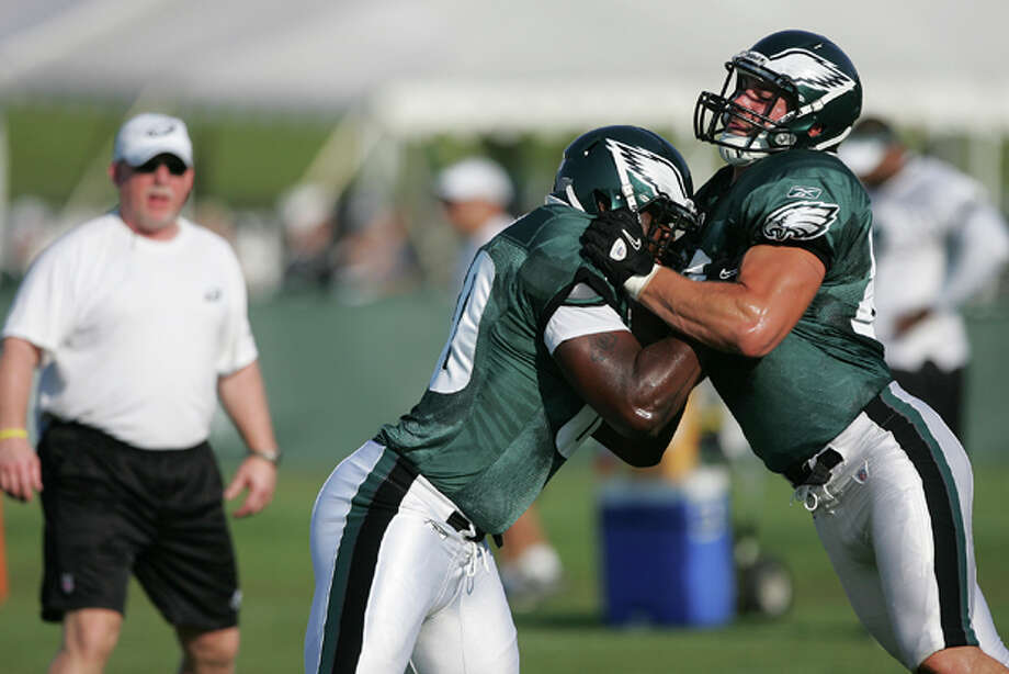 Philadelphia Eagles tight ends Martell Webb, left, battles John Nalbone, right, during the morning session of NFL football training camp at Lehigh University in Bethlehem, Pa. on Monday, Aug. 1, 2011. (AP Photo/Rich Schultz) Photo: Rich Schultz / FR27227 AP