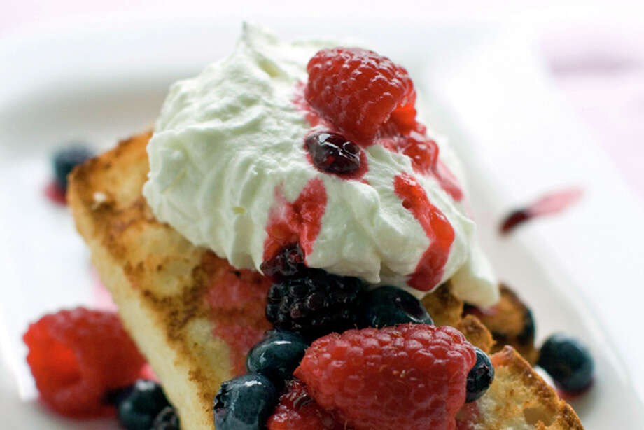 This July 18, 2011 photo shows grilled angel food shortcakes in Concord, N.H. Serve these shortcakes with whipped cream and berries. (AP Photo/Matthew Mead) Photo: Matthew Mead / ap
