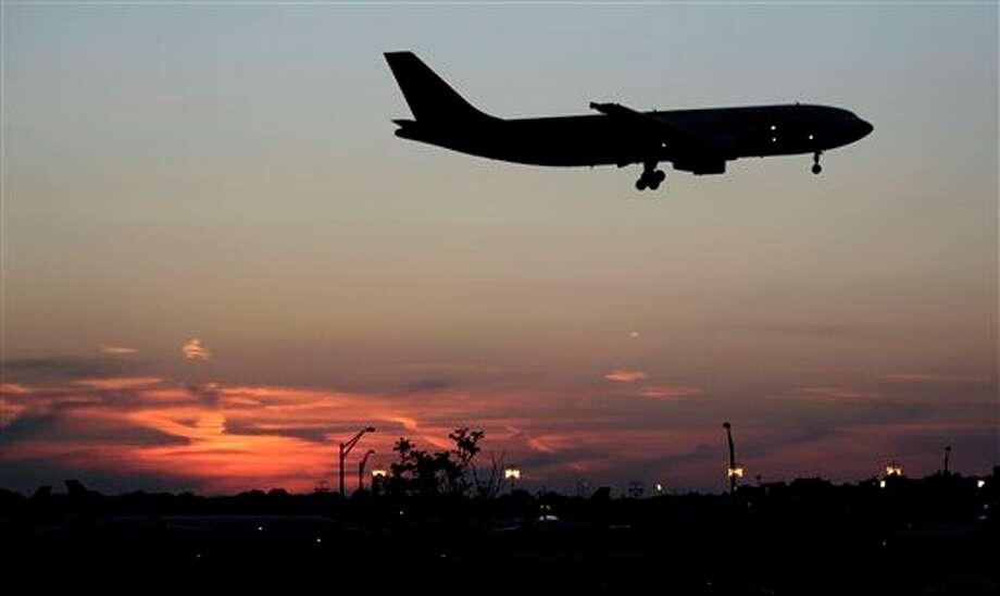 FILE- In this Wednesday, April 25, 2012, airplane lands at Newark Liberty International Airport in Newark. Shares of U.S. airlines gained Monday, Aug. 20, 2012, following a successful attempt to raise fares to cover the rising cost of fuel. (AP Photo/Julio Cortez) Photo: Julio Cortez / A2012