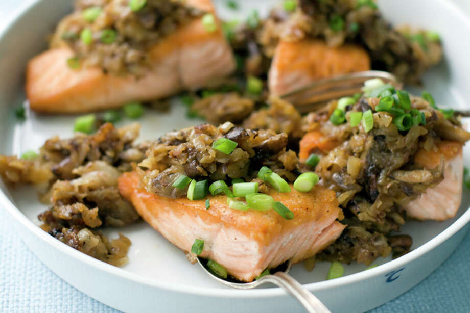 This July 18, 2011 photo shows salmon with shiitake hash in Concord, N.H. The earthy flavor of shiitake mushrooms mixed with shredded potatoes complements the rich fish. (AP Photo/Matthew Mead) Photo: Matthew Mead / ap