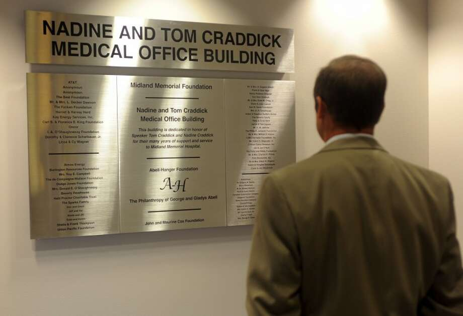 Cory Edmondson, VP of support services for MMH, looks at the new plaque naming and honoring Nadine and Tom Craddick in the medical ofice building at Midland Memorial Hospital Thursday morning. Tim Fischer/Reporter-Telegram Photo: Tim Fischer