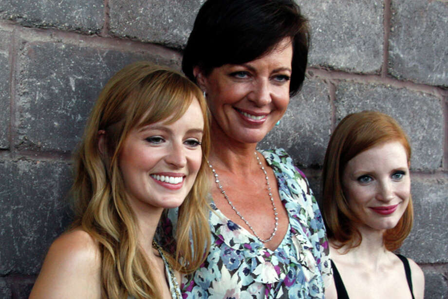 "Actresses Ahna O'Reilly, Allison Janney, center, and Jessica Chastain, right, pose for a group photograph at a benefit screening of ""The Help"" in Madison, Miss., Saturday, July 30, 2011. The film is based on the New York Times best-selling book by Kathryn Stockett about the lives of three women in the 1960s Mississippi. All three women have roles in the movie. (AP Photo/Rogelio V. Solis) Photo: Rogelio V. Solis / AP"