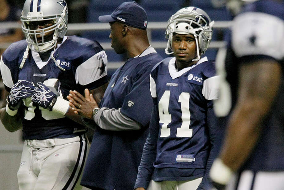 Dallas Cowboys' Terence Newman, middle right, and teammates take part in NFL football training camp Sunday, July 31, 2011, in San Antonio. (AP Photo/Darren Abate) Photo: Darren Abate / FR115 AP