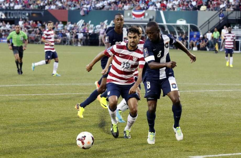 Belize's Elroy Smith, right, and United States' Chris Wondolowski chase down the ball during the first half of their CONCACAF Gold Cup soccer game in Portland, Oregon Tuesday, July 9, 2013.(AP Photo/Don Ryan) Photo: Don Ryan