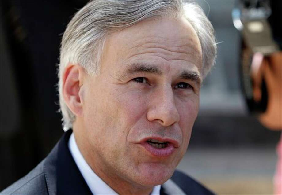 "FILE - In this July 25, 2011 file photo, Texas Attorney General Greg Abbott talks with the media as he leaves the Tom Green County Courthouse, in San Angelo, Texas. The slogan goes, ""Don't Mess With Texas."" But these days, a more appropriate cry might be: ""Try it, Washington, and we'll sue."" Abbott has filed 27 lawsuits against the federal government _ litigation that has cost his state nearly $2.8 million. That includes more than $1.5 million in salaries for state employees working on the cases, nearly $250,000 in court costs and the travel expenses of attorney general's office personnel, and roughly $1 million for outside counsel and expert witnesses, according to records obtained by The Associated Press using the Freedom of Information Act. (AP Photo/Eric Gay, File) Photo: Eric Gay / AP"