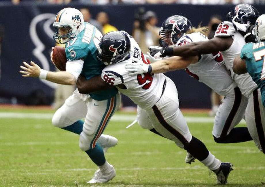 Eric Gay/APMiami Dolphins quarterback and Big Spring grad Ryan Tannehill (17) is sacked by Houston Texans defensive end Tim Jamison (96) on Sunday duirng the Dolphins' game against the Texans at Reliant Stadium in Houston. Brooks Reed (58) and Earl Mitchell (92) assisted  on the sack.