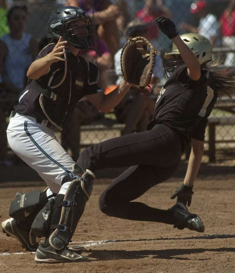 Lasers-Gold Sidney Melton, from Canton, OH, safely slides into home as Tennessee Fury's catcher Morgan Harris waits on the ball Sunday in the championship game of the ASA National Tournament. Photo by Tim Fischer/Midland Reporter-Telegram Photo: Tim Fischer