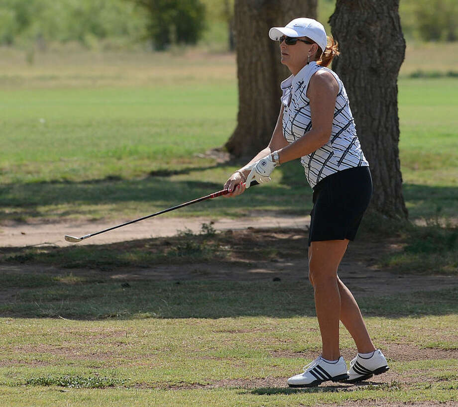 Lacy Gasser watches her second shot on the ninth hole during her semi-final match against Penny Perry at the Women's West Texas Golf Association Championship Thursday at Odessa Country Club. Photo: Mark Sterkel|Odessa American