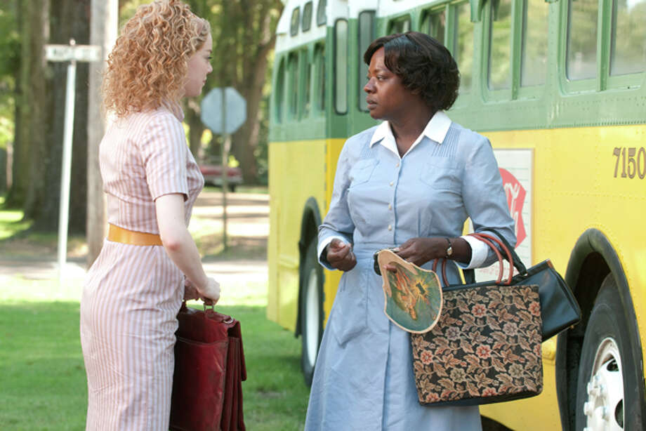 """In this film publicity image released by Disney, from left, Emma Stone and Viola Davis are shown in a scene from """"The Help."""" (AP Photo/Disney, Dale Robinette) Photo: Dale Robinette / ©DreamWorks II Distribution Co., LLC. All Rights Reserved."""