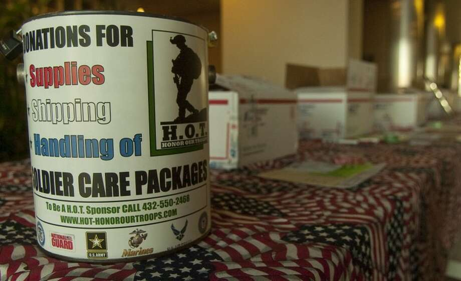 HOT, or Honor Our Troops, sets up their display table inside EOG Resources Thursday to help generate donations for care packages to send to troops overseas. Photo by Tim Fischer/Midland Reporter-Telegram Photo: Tim Fischer