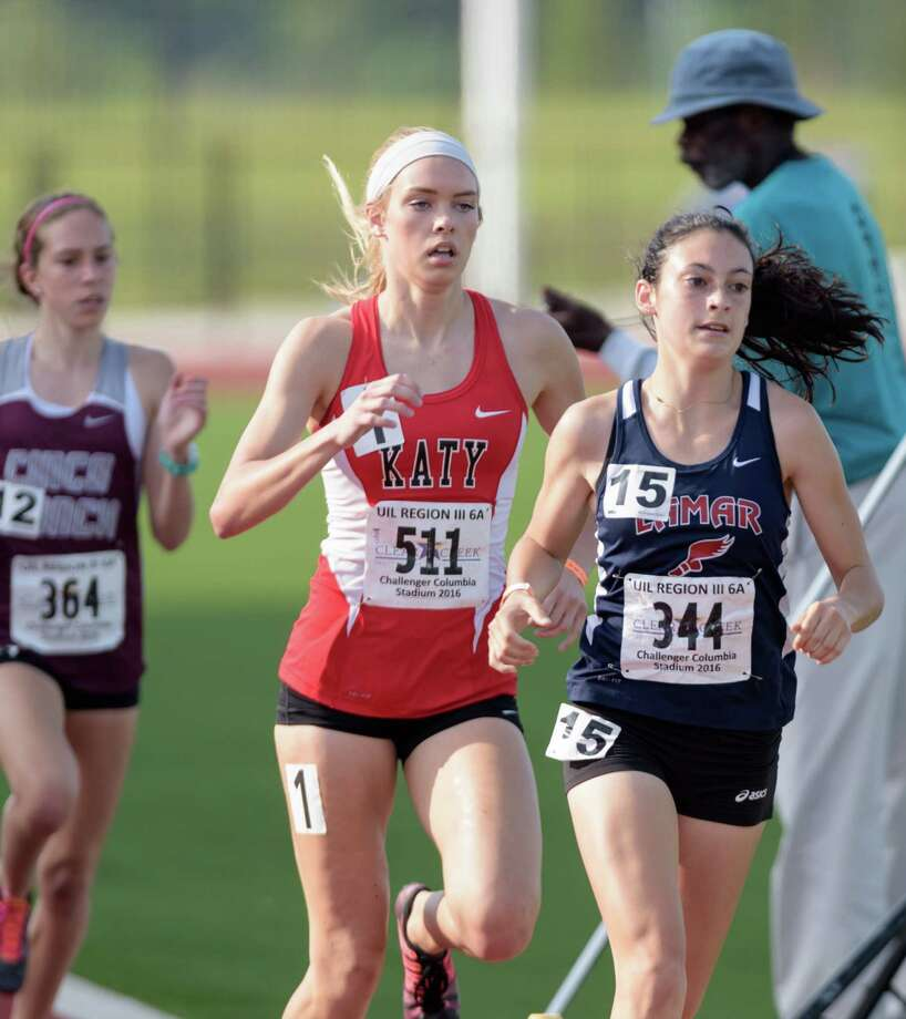Lamar junior Julia Heymach, right, won the 1600-meter run at the UIL CLass 6A State Track & Field Championships after a third-place finish in the 3,200 the day before. Photo: Wilf Thorne / © 2016 Houston Chronicle