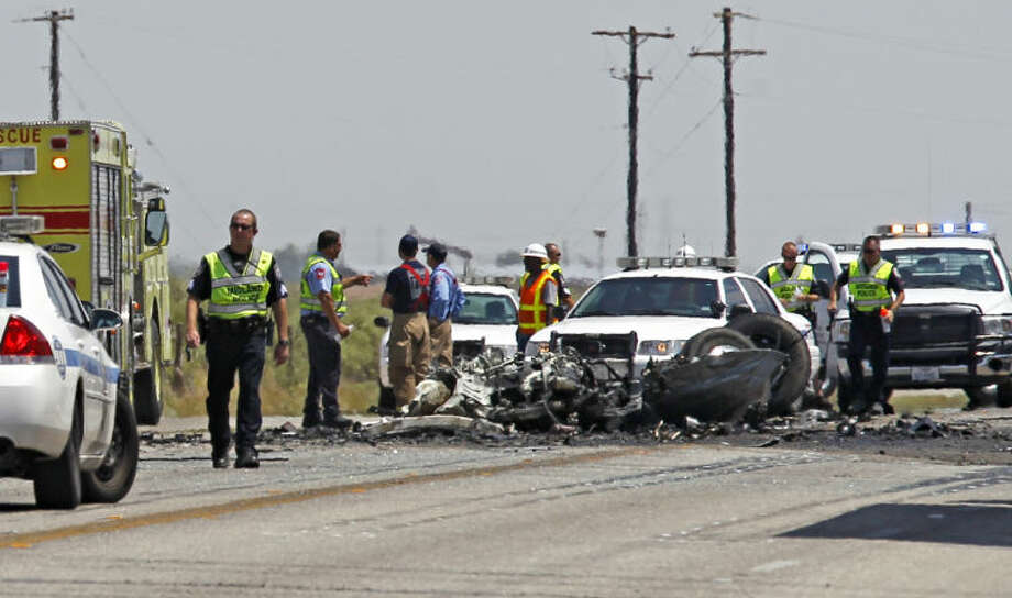 Fatal two-vehicle accident involving a passenger car and an 18-wheeler on 1788 Tuesday. James Durbin/Reporter-Telegram Photo: JAMES DURBIN