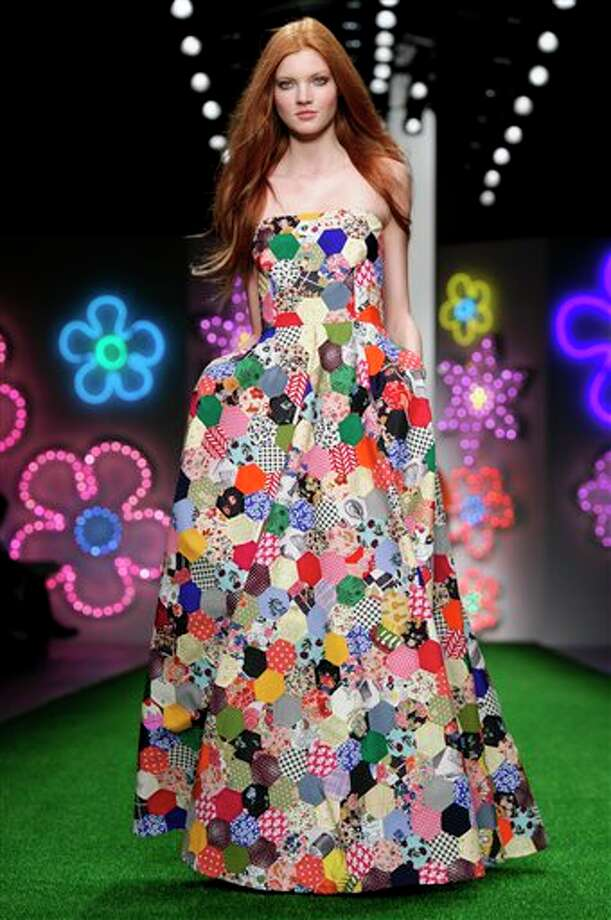 A model wears a design from the Jasper Conran Spring/Summer 2013 collection during London Fashion Week, Saturday, Sept. 15, 2012. (AP Photo/Jonathan Short) Photo: Jonathan Short / AP