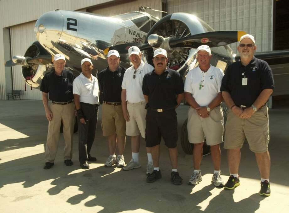 Bob Keating, Jerry Perales, owner James Martin, Bill Coombes, Mark Baxter, Greg Gutting and Paul Cooper make up the team that manages and flies the award-winning 1942 Beech SNB. Photo by Tim Fischer/Midland Reporter-Telegram Photo: Tim Fischer