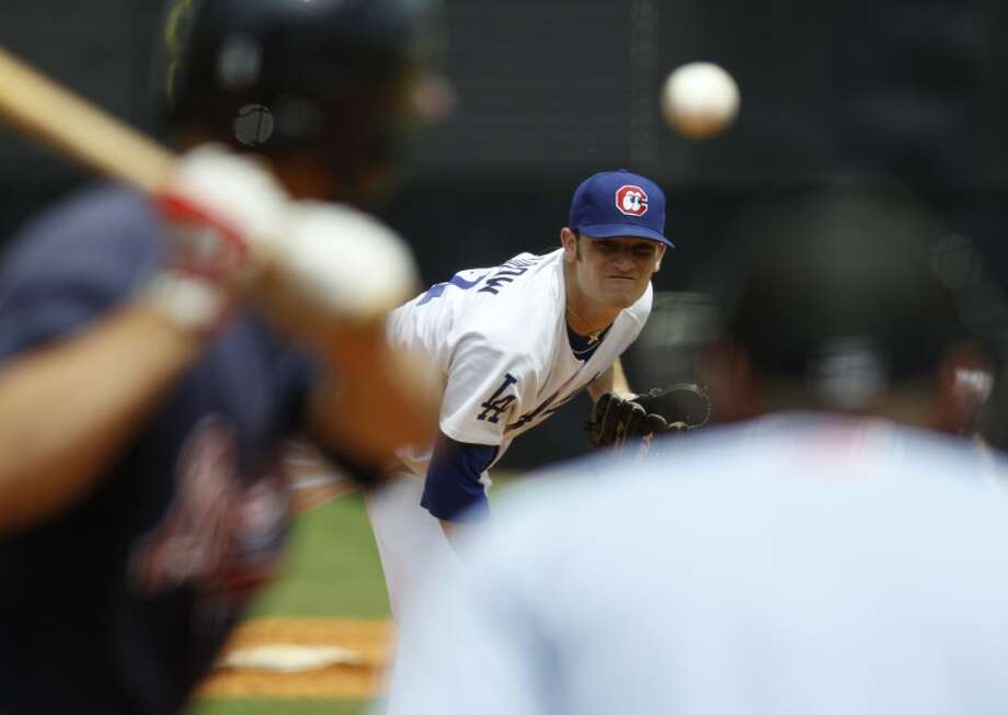 Staff photo by Dan Henry/Chattanooga Times Free Press - Chattanooga Lookouts pitcher Chris Withrow (21) pitches against the Mississippi Braves during a home game at AT&T field Wednesday afternoon. Photo: Dan Henry