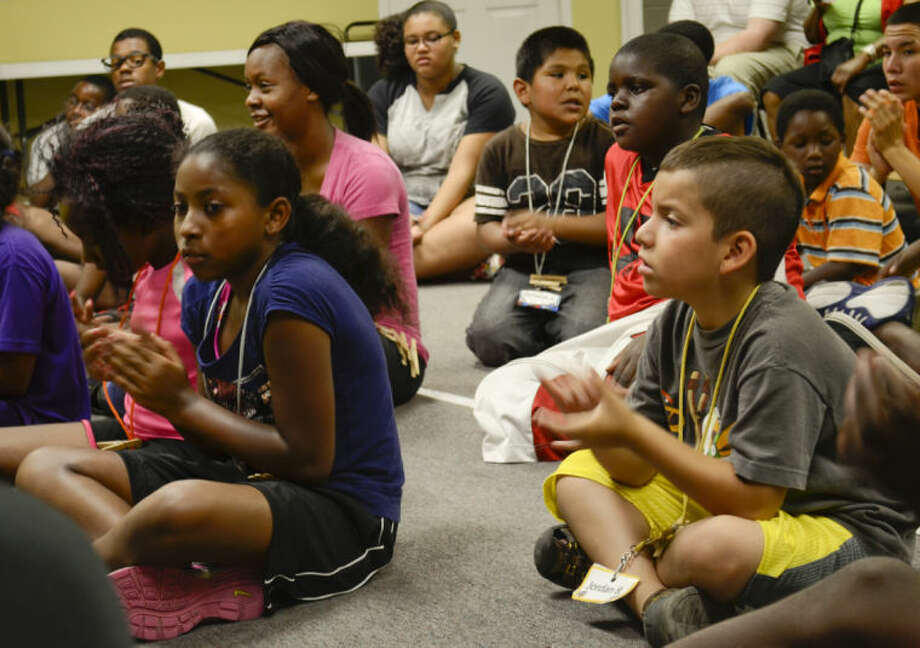 Children at Cross Ministries, an outreach of Fairmont Park Church of Christ, sing praise songs during worship time at Cross Ministries day camp. Tim Fischer\Reporter-Telegram Photo: Tim Fischer