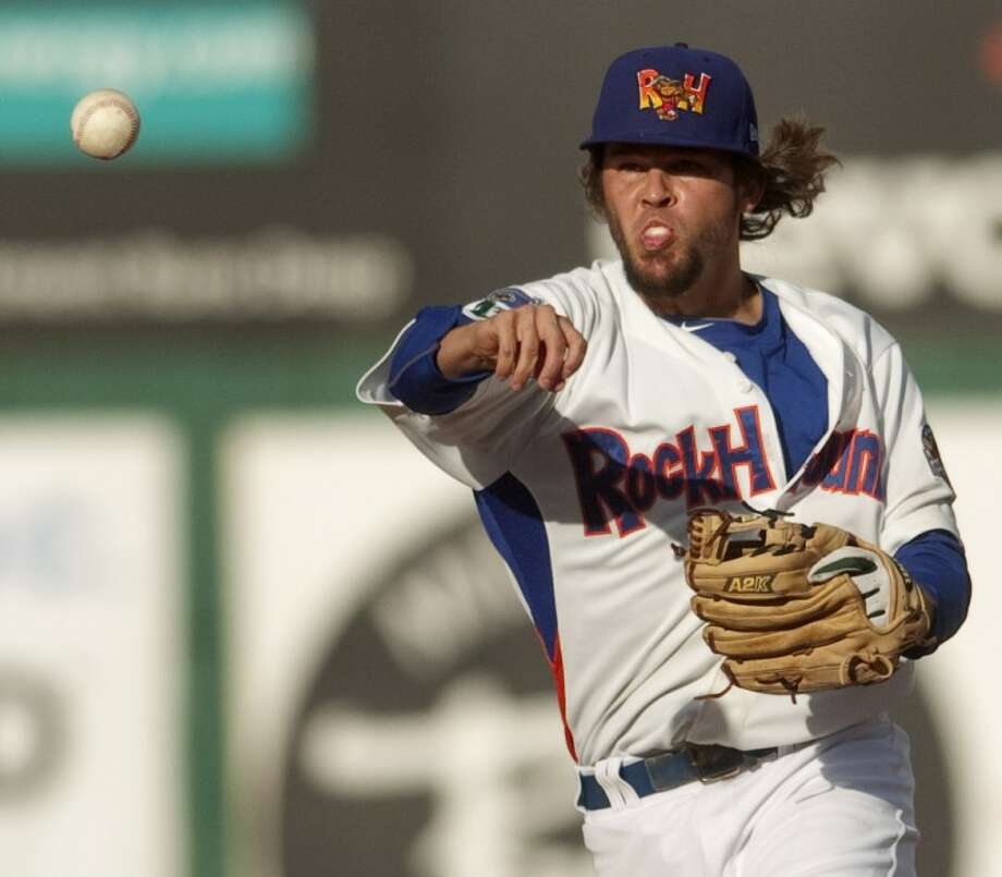 RockHounds second baseman Wes Timmons makes the throw to first after fielding a ball up the middle Saturday night at CitiBank Ballpark. Photo by Tim Fischer/Midland Reporter-Telegram Photo: Tim Fischer