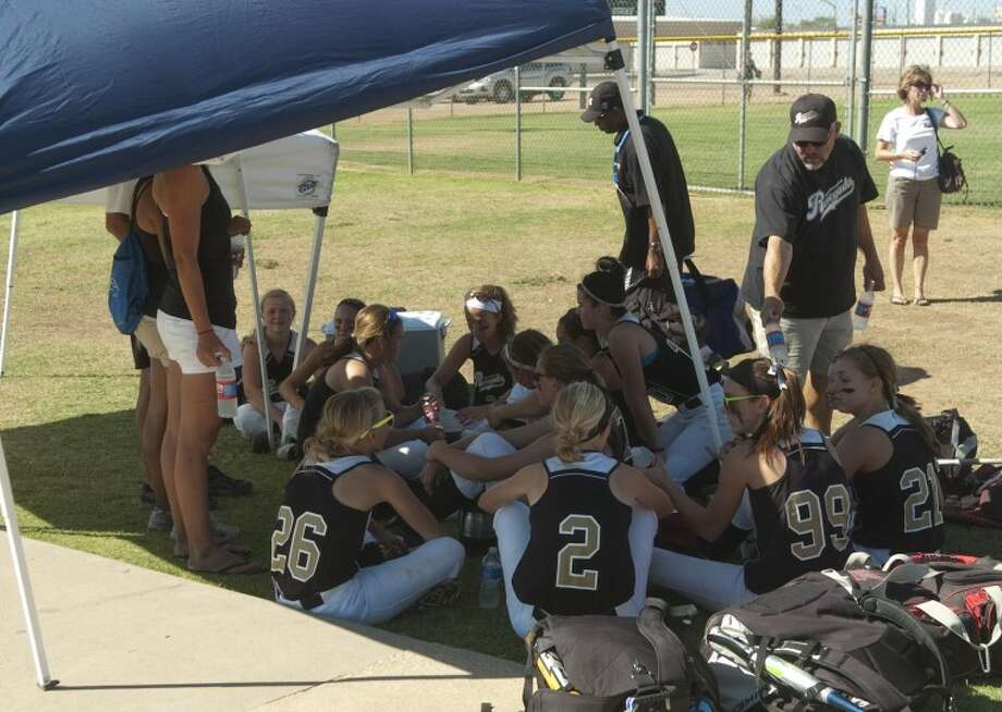 Softball teams do their best to stay cool during daytime