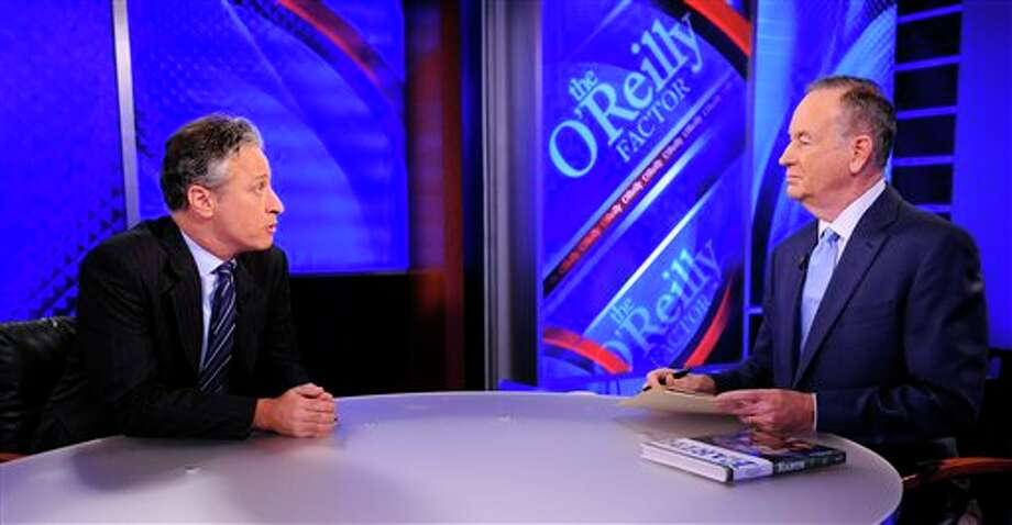 """FILE - This Sept. 22, 2010 file photo shows Comedy Central's Jon Stewart from """"The Daily Show with Jon Stewart,"""" left, and and political pundit Bill O'Reilly during an interview for """"The O'Reilly Factor"""" on FOX News Channel, in New York. O'Reilly and Jon Stewart face off for a special 90-minute debate about the 2012 presidential race. The live debate will be streamed online on Oct. 6, 2012 from George Washington University in Washington, D.C. The price is $4.95, with one-half of the profits donated to a number of unspecified charities. (AP Photo/Peter Kramer, file) Photo: Peter Kramer / KRAPE"""