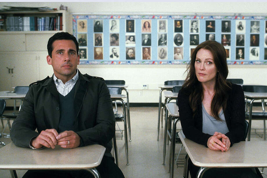 "In this film publicity image released by Warner Bros. Pictures, Steve Carell, left, and Julianne Moore are shown in a scene from ""Crazy, Stupid, Love."" When Carell's character learns that his wife (Moore) has cheated on him, they split and he starts sleeping all over town. But he, taking inspiration from his young son, eventually realizes his true love for his wife and their reunion seems promising. (AP Photo/Warner Bros. Pictures) Photo: HOEP / ©2011 Warner Bros. Entertainment Inc."